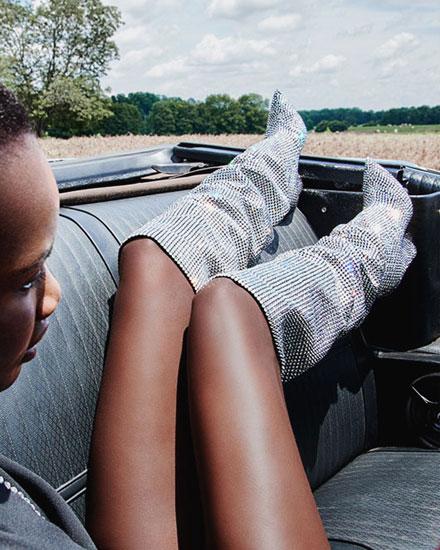 LOVIKA | Fall boots fashion editorial featuring Saint Laurent metallic knee-high slouchy boots