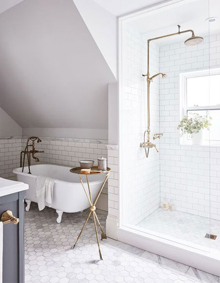 Bathroom interior design with gold fixtures and accents